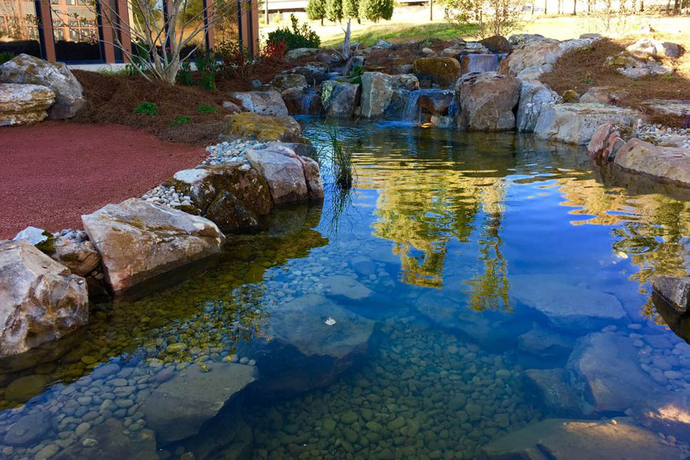 Large Waterfall Into Pond