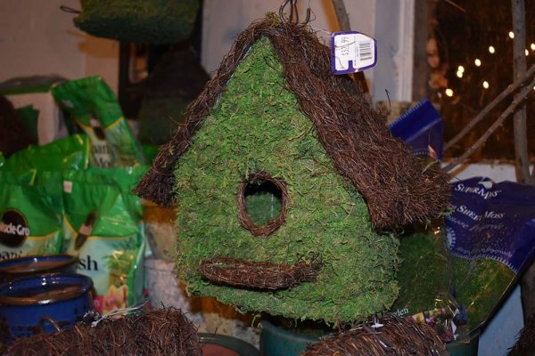 Natural green and brown bird house