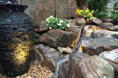 Vase Fountain Next To Stream