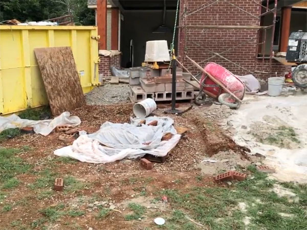 This messy yard is part of the process for how to build a koi pond